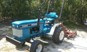 Ford 1120 diesel tractor with finishing mower for Sale in Vidalia, GA
