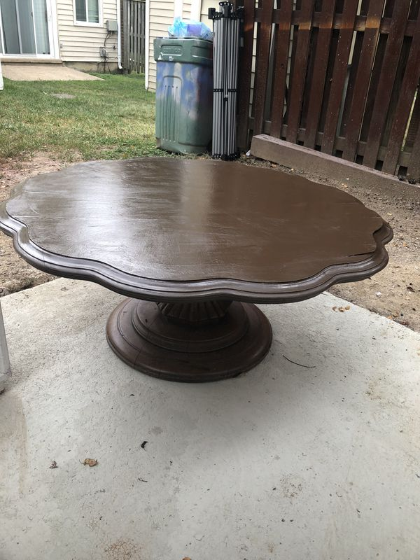 Brown antique uniquely shaped table