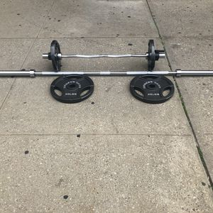 7 foot Olympic bar : Curl bar / 2:45 Olympic plates /2:25 Olympic plates on the curl bar for Sale in Queens, NY