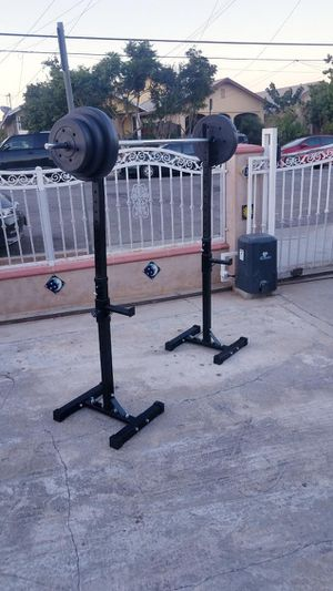 "Space saving Squat rack with safety catchers, 6' standard barbell 1"" and 100lbs weight set for Sale in Montebello, CA"