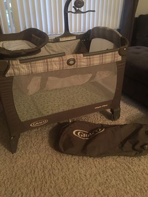 Graco playpen w/ changing table, musical mobile , like new for Sale in Riverside, CA