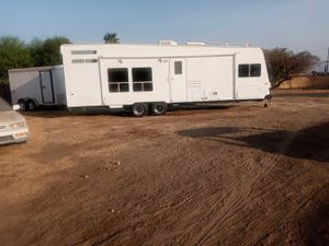 Toy hauler really good condition two beds generaror tv everitme works for Sale in San Bernardino, CA