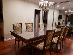 High end custom made wood dinning room set. 6 regular chairs and 2 arm chairs. The table size it 100 x46 inches and it comes with an extra extension for Sale in Los Angeles, CA