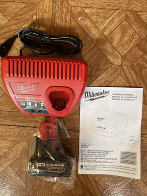 Milwaukee. M12 Lithium Ion Charger and XC 4.0Ah Battery Pack. for Sale in Brooklyn, NY