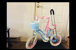 Girl's bike with training wheels and extra fitting handle. for Sale in Issaquah, WA