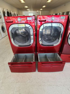 Lg front load washer and electric dryer set with pedestal used in good condition with 90 days warranty for Sale in Frederick, MD