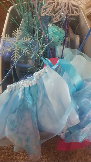Frozen party decor including vases, linens, teel, plates and plastic snow and blue serving trays for Sale in Modesto, CA
