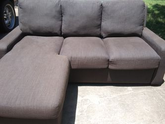 Dark grey sectional with pull out bed for Sale in Cedar Park,  TX