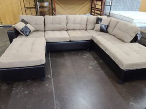 Two tone tan microfiber sectional with a matching ottoman for Sale in Sacramento, CA