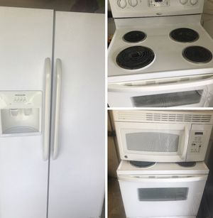 "Frigidaire ""stove,over the range microwave and fridge everything works fine!! for Sale in Kissimmee, FL"