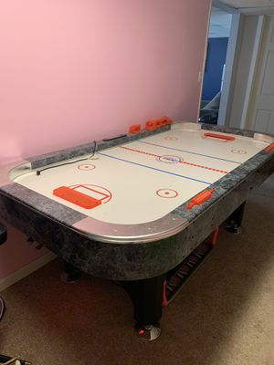 Air hockey table, four pucks and paddles. Good working condition !! for Sale in Moon, PA