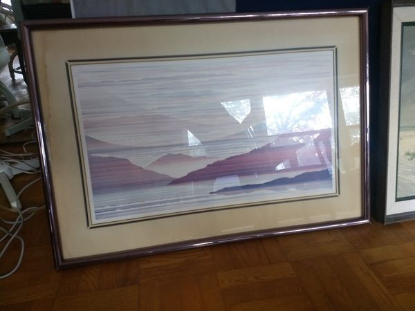 Scenery picture with glass cover surface and golden frame