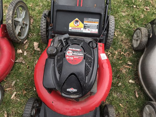 Lawn Mowers and a tractor