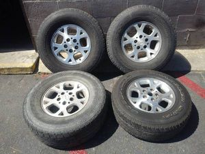Aluminum 16 inch jeep wheels and tires 5 on 5 lugs for Sale in Montebello, CA