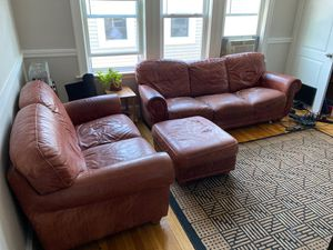 Leather couch/love seat/ottoman + rug set for Sale in Boston, MA