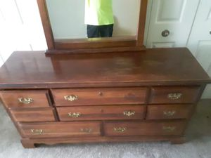 Solid wood dresser with attached mirror for Sale in Newport News, VA