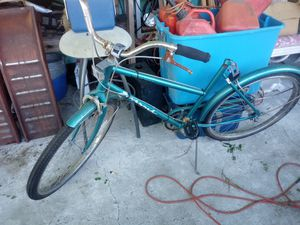 The 10-speed is a Schwinn World sport the black good by vibrations for Sale in Sebring, FL