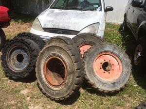 Solid skid steer bobcat wheels tires for Sale in Spring Hill, FL