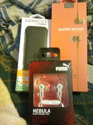 Ear phones set new in box.,puma,wind wing Earbuds both with built in Microphone.& power pack for Sale in Kissimmee, FL