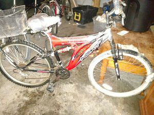 Bike with shocks and rear basket for Sale in Dickinson, ND