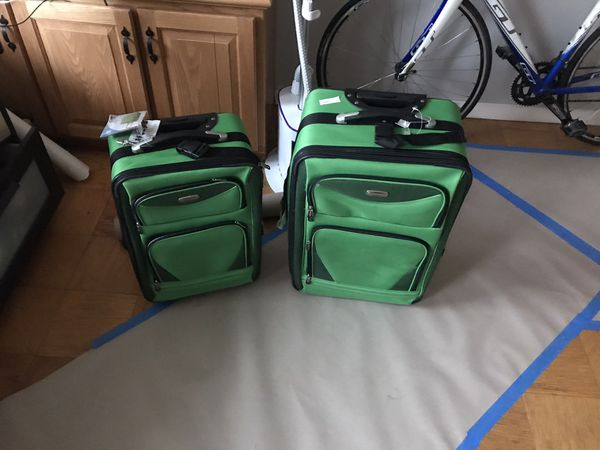 2 suitcases small and medium. New.