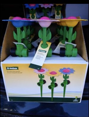 Melnor Decorative Daisy Lawn Sprinkler Pink New with Tags ///box of 12 for 45$$we have 2 for Sale in Clearwater, FL