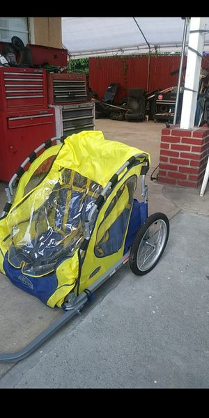 In step bike trailer for kids for Sale in Phillips Ranch, CA