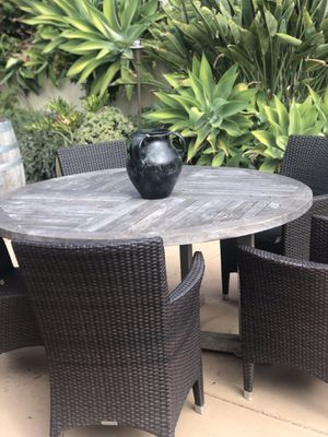 59 inch teak table with 6 outdoor rattan chairs 3 with arms and 3 with out for Sale in Spring Valley, CA