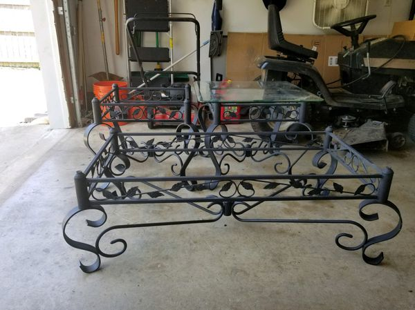 Glass and black rod iron Coffee table and end tables with glass tops. Glass is included