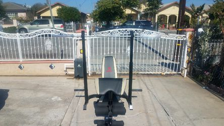 7 foot Olympic barbell 45lbs with clips, Olympic Bench and squat rack combo with Preacher curl and leg developer Brand new in box for Sale in Montebello,  CA