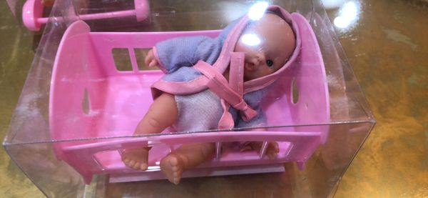 Set of six baby dolls and furnitures