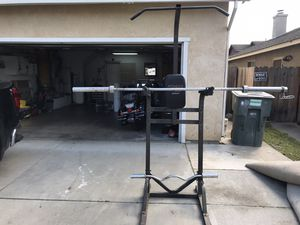 Olympic bar and curling bar for Sale in Modesto, CA