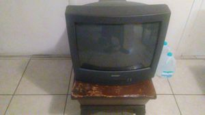 A sharp tv and an antique stand tv works $40. for Sale in West Palm Beach, FL
