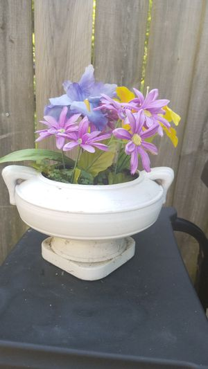 Nice little garden outdoor pot for indoor whichever you prefer artificial flowers in it about a 10in by 10in Circle in about 6 in tall for Sale in North Ridgeville, OH