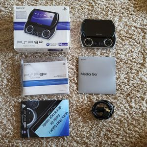 Psp go with box and charger for Sale in San Antonio, TX