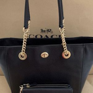 Coach Black Leather Tote Bag with matching wallet NWT serious inquires only please Low offers will be ignored Pick up only Pick up location in the for Sale in Santa Fe Springs, CA