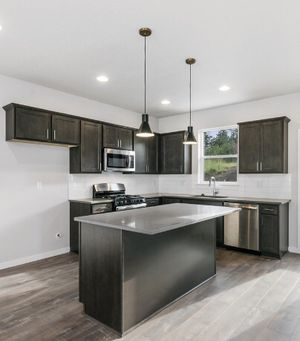 Black/brown and gray quartz -Full kitchen cabinets with quarts with island..brand new.... appliances not included but sold separately.. remodel your for Sale in Portland, OR