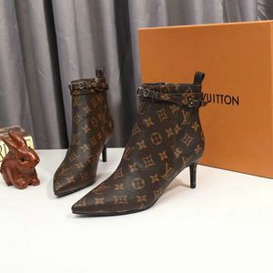 Louis Vuitton Monogram heel boots for Sale in Griffith, IN