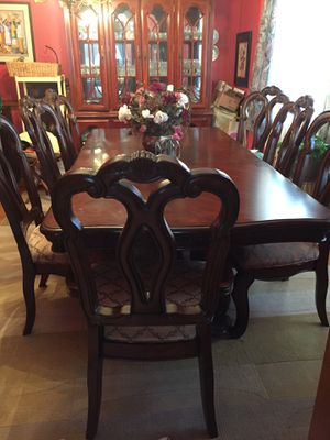 Table with 8 chairs and an extension for Sale in Wake Forest, NC
