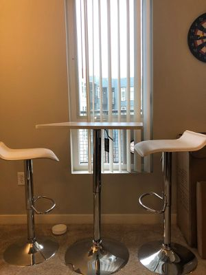 Adjustable bar table with 2 bar chairs for Sale in Seattle, WA