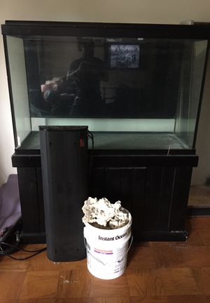 150 gallon tank and stand with salt rocks for Sale in Washington, DC