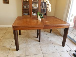 Antique solid wood 3 leaf extending dining room table for Sale in Citrus Heights, CA