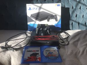 PS4 SLIM 1 TB WITH 2 CONTROLLERS + CHARGING STATION + NBA 2k18 + WITH ALL WIRES USB CABLE INCLUDED WITH BOX for Sale in Fairfax, VA