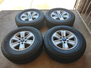 265 70 17 very good set tires with rims Ford f150 expedition 6 lugs tires Firestone destination all terrain have good tread left for Sale in Phoenix, AZ