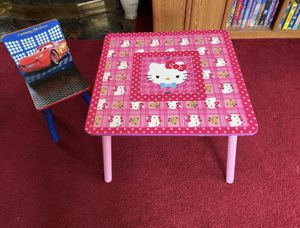 KIDS HELLO KITTY TABLE WITH CENTER STORAGE NETTING ~ CARS CHAIR $12 for both for Sale in Paramount, CA