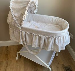 LIKE NEW Gender neutral Baby Moses Bassinet 7pc. Pillow, Blanket, Sheet, Pad, Frame, removable Bassinet & basket, folds flat ❗️IF POSTED THEN AVAILAB for Sale in Plainfield,  IL