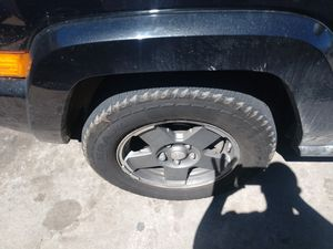 4 Jeep wheels and tires lug 5x5 or 5x127 for Sale in Denver, CO