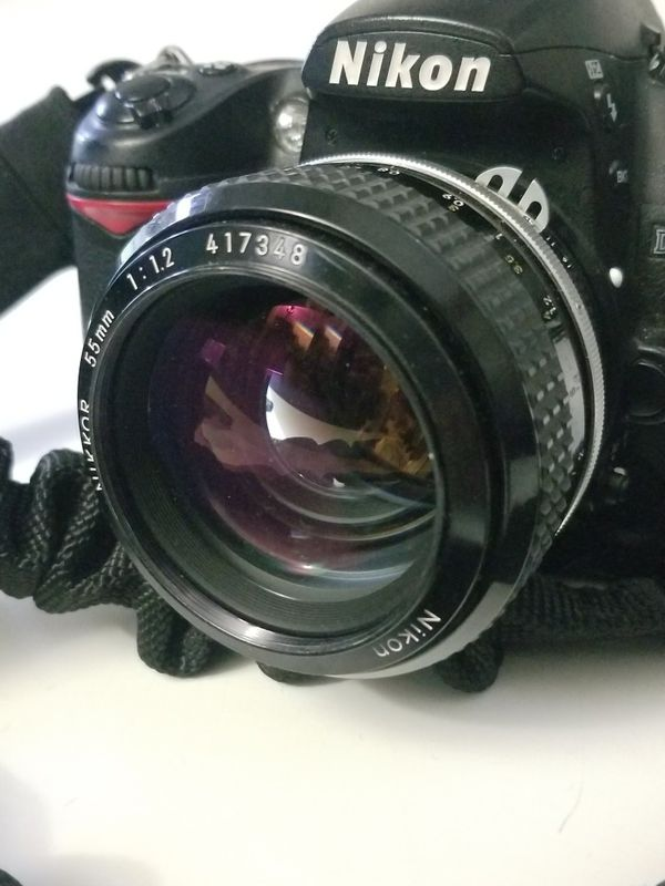 Nikon DSLR D7000 + 50mm 1.2 lens + SB-800 flash + accessories and bungee sling strap
