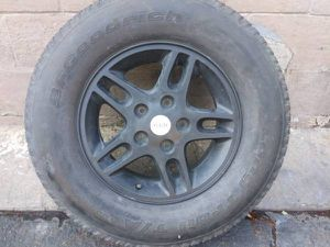 16 inch Jeep Grand Cherokee alloy wheel and tire, 5 on 5 great spare for Sale in Montebello, CA