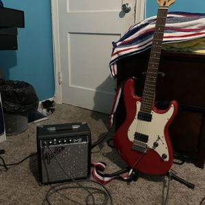 ELECTRIC GUITAR WITH STRAP,AMP,10FT CORD,GUITAR STAND FOR TRADE OR CASH for Sale in Hyattsville, MD